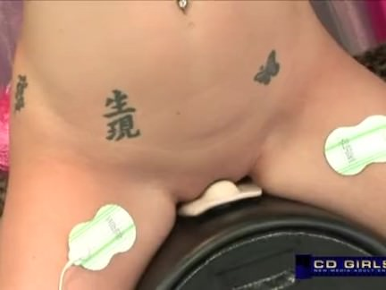 Busty babe rides the sybian